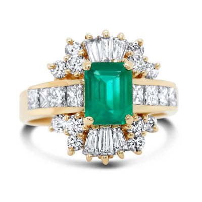 14k yellow gold emerald and diamond antique ring with an intricate diamond halo