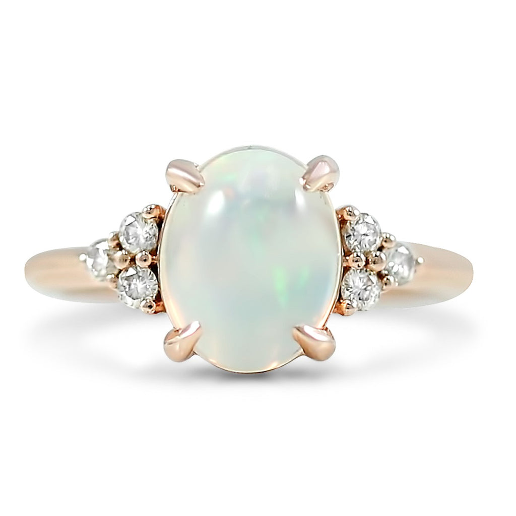 14k rose gold oval opal engagement ring with clusters of diamonds on each side under $1000
