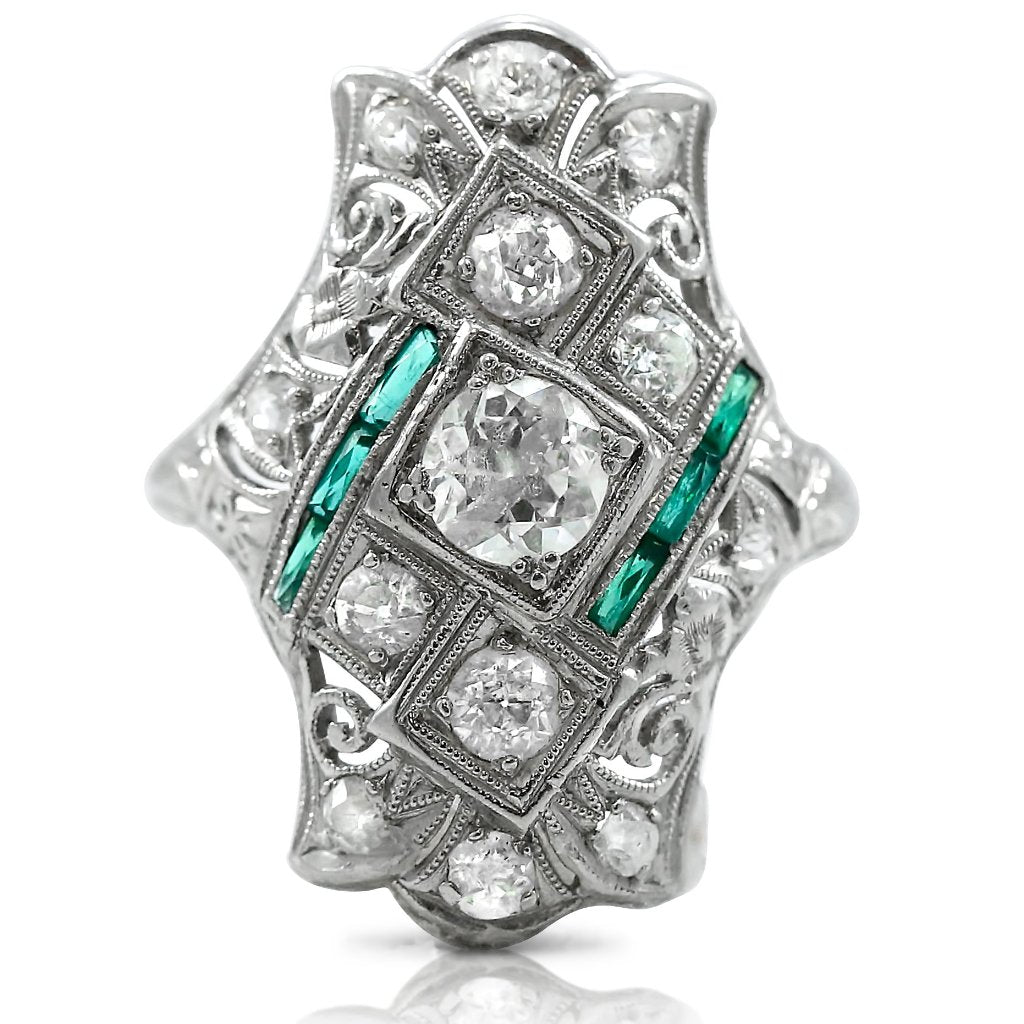 Art Deco inspired dinner ring with old European cut diamond and emeralds made with platinum