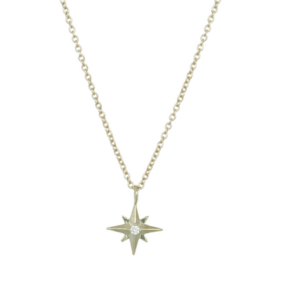 14k yellow gold star necklace with a dainty round diamond 16in long chain under $500