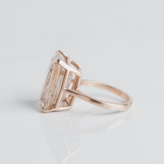 yellow gold and prong set quartz ring