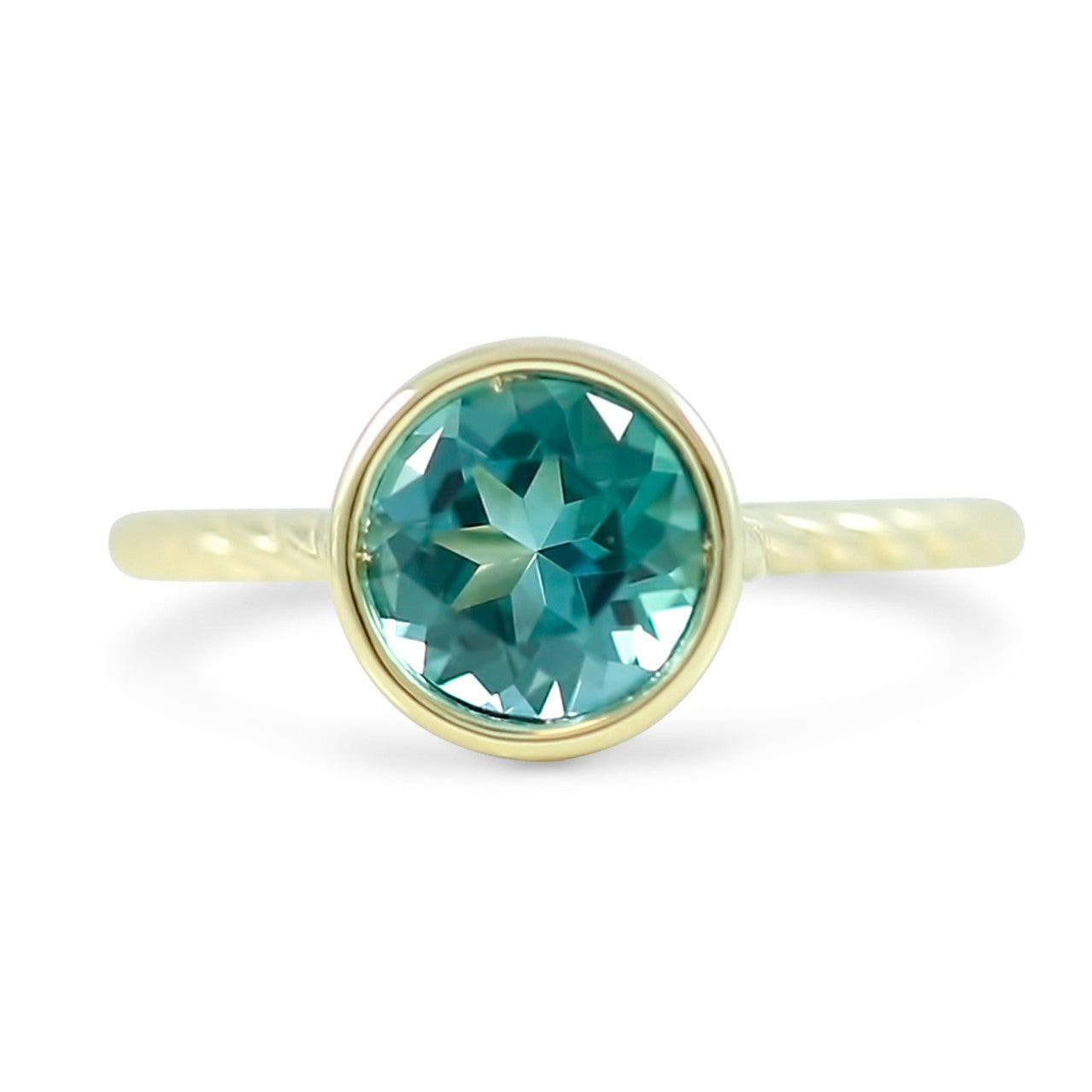 1.26ct round blue tourmaline ring bezel set in 14k yellow gold with a rope band