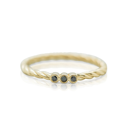 yellow gold braided band and black diamond three stone stack rings