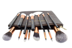 Set of makeup brushes lying on their case