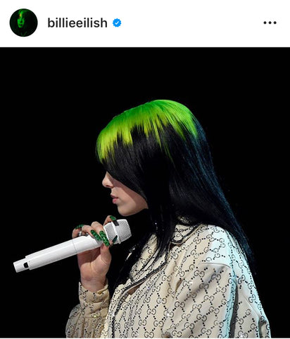 Lime green hair roots on Billie Eilish