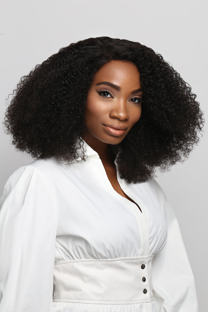 Best Natural hair side part Kinky Curly hair extensions on Black woman Model in 18 inches by SL Raw Virgin Hair Company