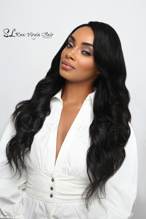 Beautiful Black women wearing Raw Human Hair Extensions Long 24 inch Coarse Wavy Bundles by SL Raw Virgin Hair Company