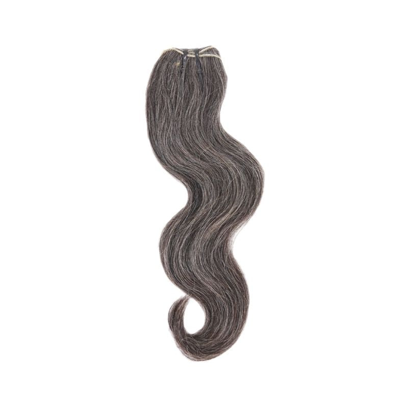 Displayed is SL Raw Virgin Hair Salt and Pepper gray hair vietnamese human hair bundles with a slight wave. beautiful hair wefts for a perfect sew in or pronto weave