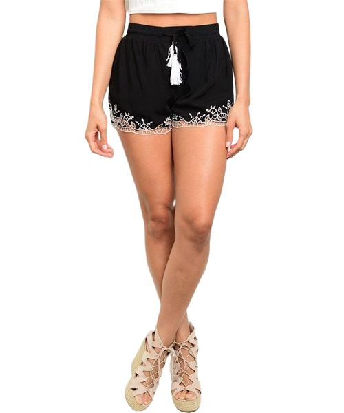 Black and white woven shorts with gathered elastic waistband and embroidered trim. - Shop Canary Clothing