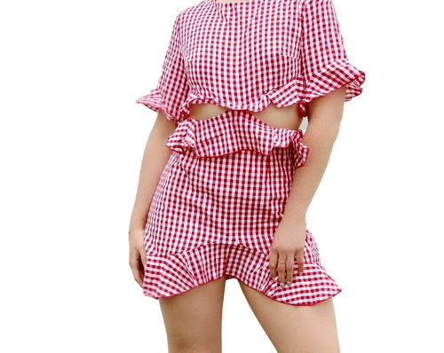 Ready for a picnic with this Red and white gingham dress. Style this with some white sneakers or your favorite wedge sandals -  Shop Canary Clothing