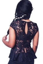This black sheer lace top features a peplum detail, a round neckline and short sleeves - Shop Canary Clothing