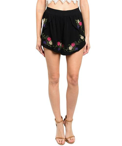 Black flounce shorts features multicolored floral embroidery and high waisted smocked waist - Shop Canary Clothing