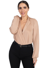 Perfectly polished elegant beige draped collared bodysuit. This lustrous champagne color creates a stunning romantic style, providing a figure-hugging stretch for a close fit, making it easy to layer under pants or a skirt.  - Shop Canary Clothing