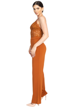 An elegant jumpsuit like this is what you need to party!  Spicy cognac orange color jumpsuit featuring a lace floral crochet. Solid wide-cut leg bottoms. Sleeveless. Zipper on the back. No pockets. V-Neckline. Just add some strappy heels for a classy but sassy look.  95% Polyester, 5% Spandex- Shop Canary Clothing