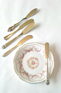 Silver-Plated Butter Knives with Vintage Mismatched China