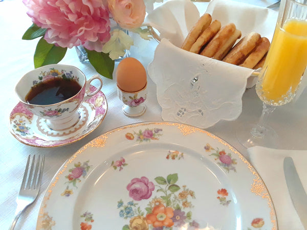Royal Table Settings brunch setting with vintage egg cup, teacup and crystal champagne glass.