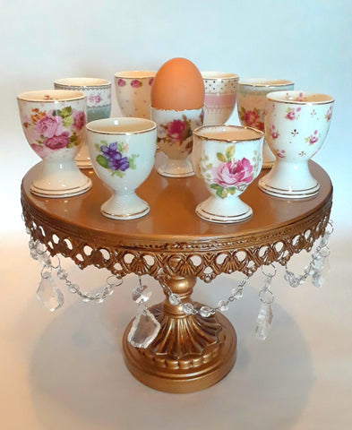 Egg Cups with gold detail and colorful flowers.