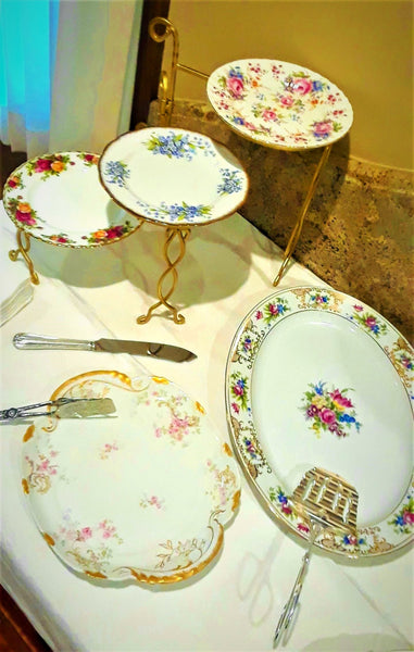 3-Tier Gold Stack Serving Tray with Vintage Plates next to Large Serving Platter and Cake Plate