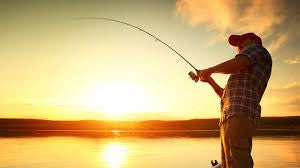 Angler Fishing on lake in the sunset
