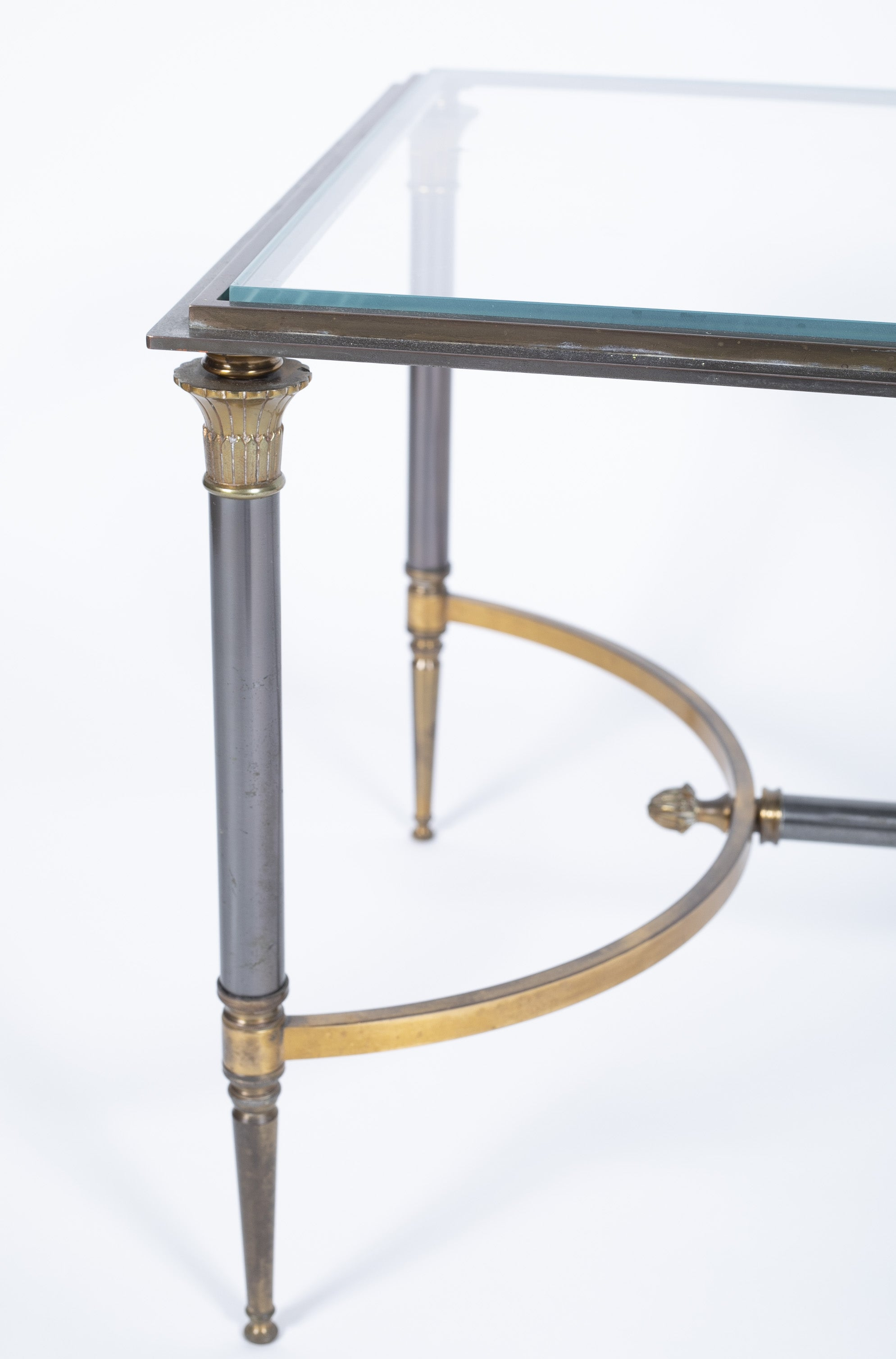 A Gilt Bronze and Steel Coffee Table By Maison Charles