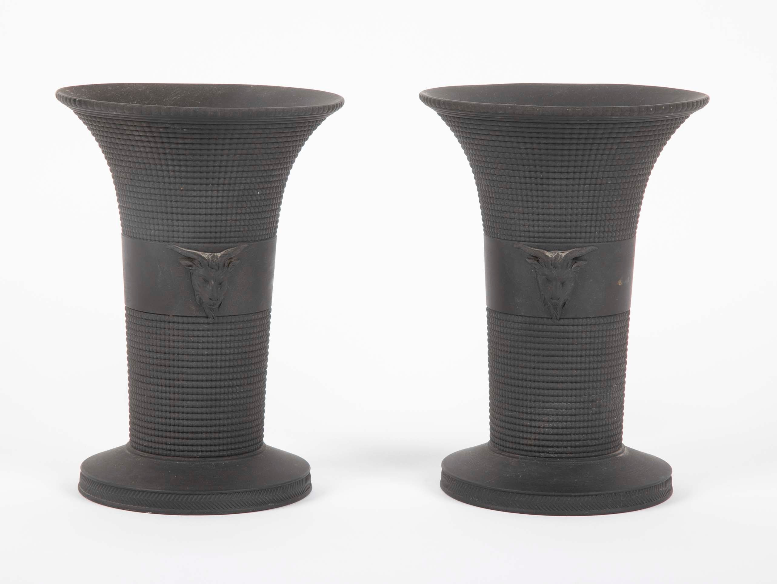 A Pair of Black Basalt Wedgwood Textured Vases with Rams Heads