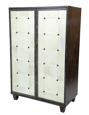 A Two Door Ebonized and Cerused Cabinet