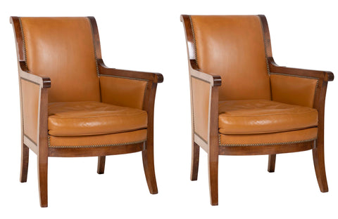 A Pair of Directoire Cognac Leather Bergeres