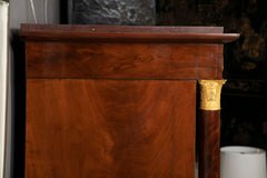 A Molitor French Empire Flame Mahogany and Gilt Bronze Commode with Rouge Griotte