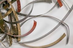 "Mixed Metal Wall Sculpture titled ""Saturn's Rings"" by Silas Seandel"