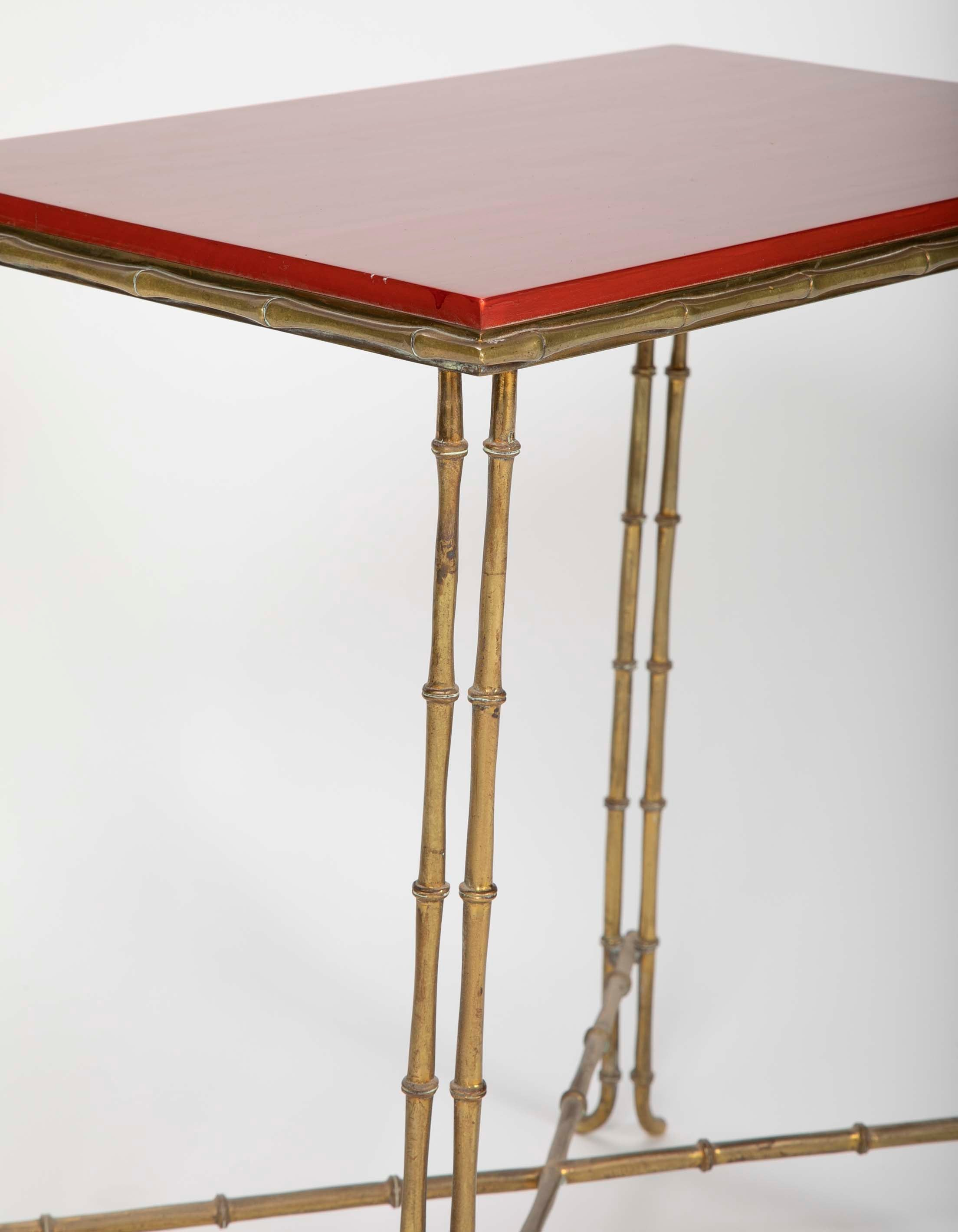 A Brass Bamboo Form Cocktail Table by Bagues with Red Lacquered Wood Top