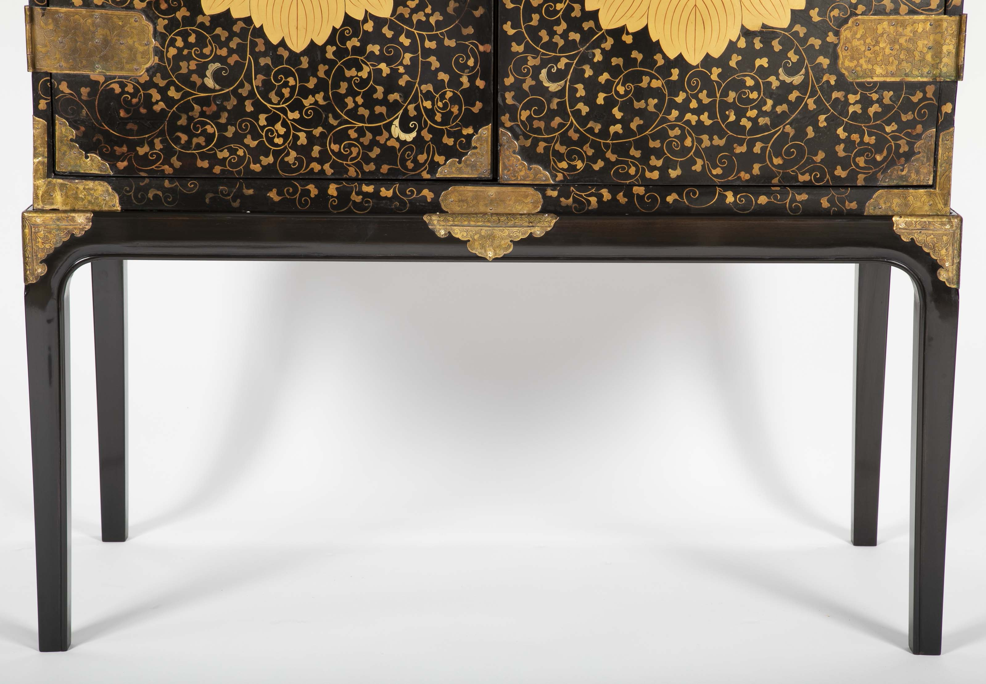 A Large Japanese Black and Gold Lacquered Cabinet on Stand with Gilt Mounts