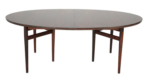 A Rosewood Dining Table designed by Arne Vodder for Sibast Furniture