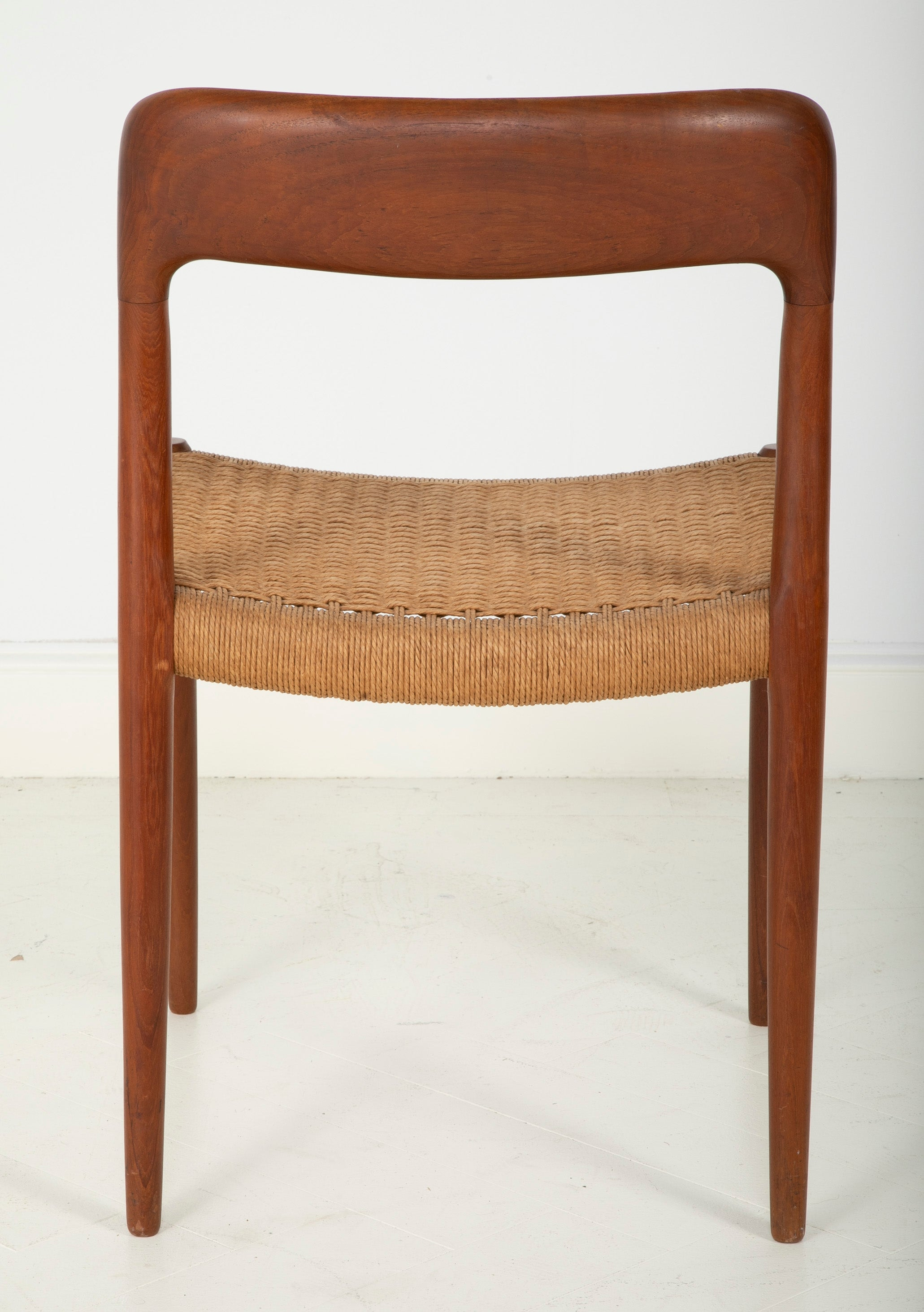 A Set Of Eight Danish Cord Seat Dining Chairs