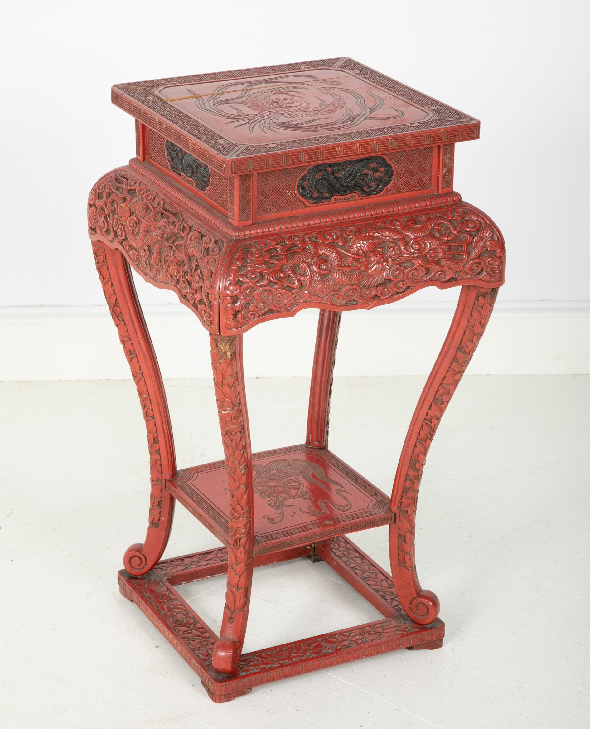 A Cinnabar Lacquer Stand of Square Sectioned Form