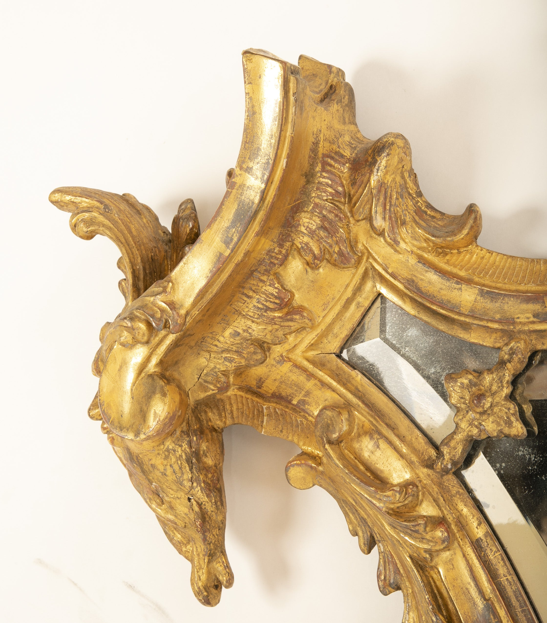 Baroque Italian Mid-18th Century Gilt Mirror with Faces
