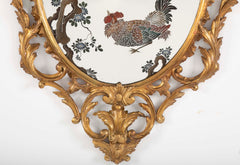 George III Oval Gilded Mirror with Reverse Painted Glass