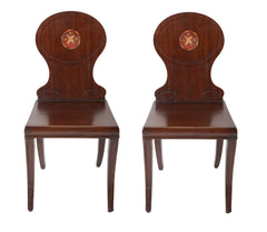 A Pair of Late Georgian Mahogany and Polychrome Hall Chairs