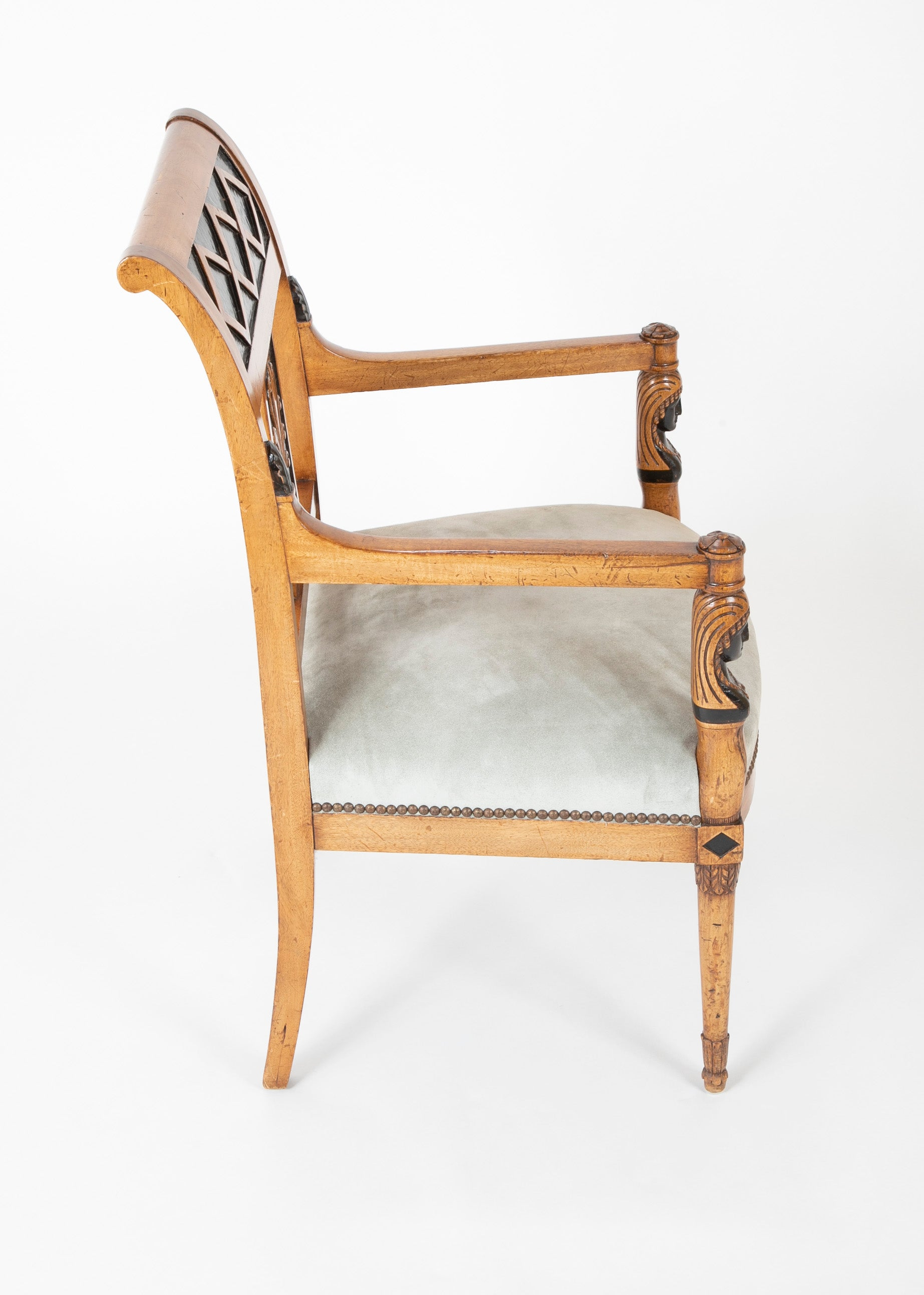 A Pair of Continental Neoclassical Chairs with Carved Egyptian Head on the Arm