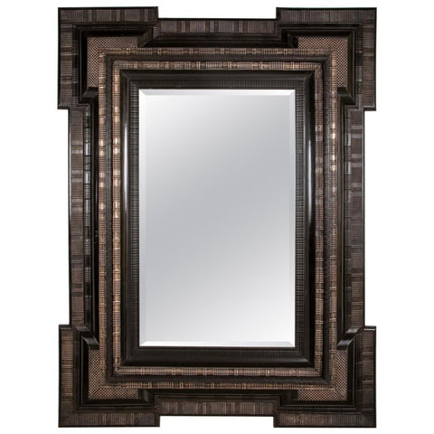 A Large Silvered Metal Mounted Dutch Mirror