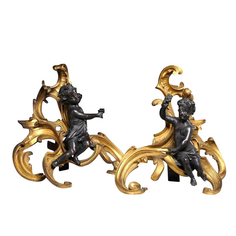 Pair of Bronze and Ormulu Chenets Modeled After Clodion