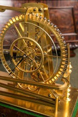 A Gilt Brass Waterwheel Timepiece by Peter Bonnert