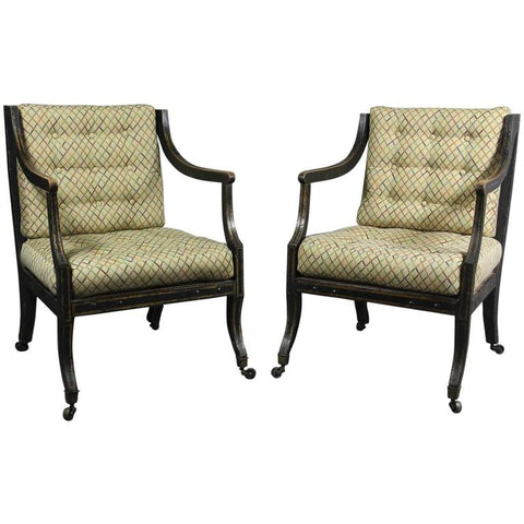 Pair of Regency Ebonized and Gilded Caned Armchairs