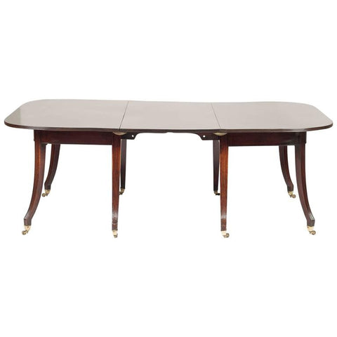 English Regency Mahogany Dining Table with Dramatic Saber Legs