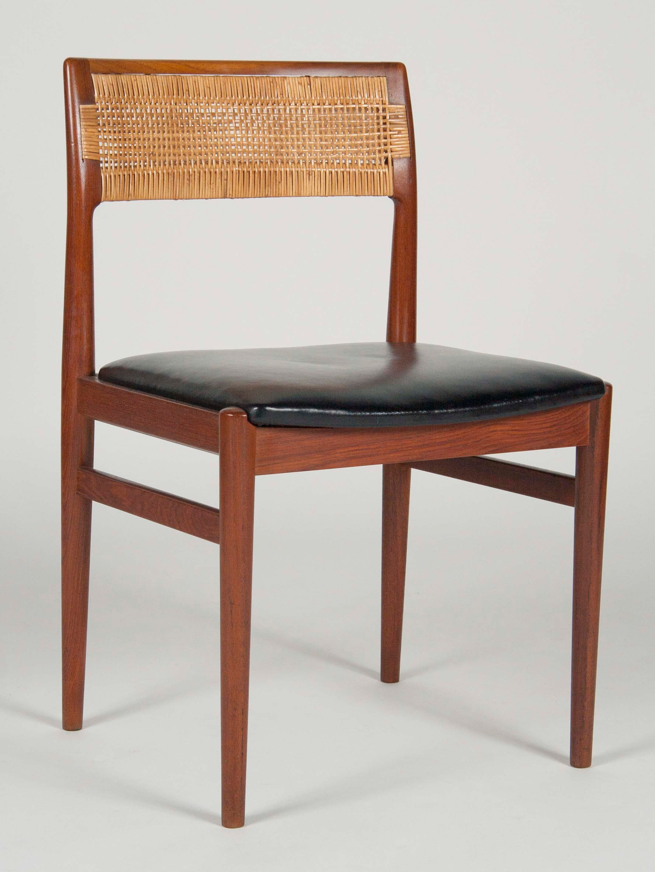 A Set of 4 Model W26 Teak Chairs designed by Erik Worts