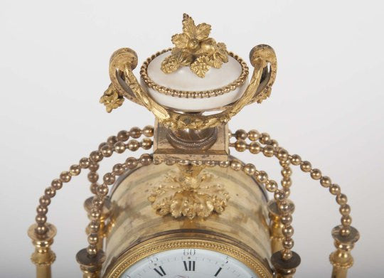 An 18th Century Gilt Bronze French Portico Clock