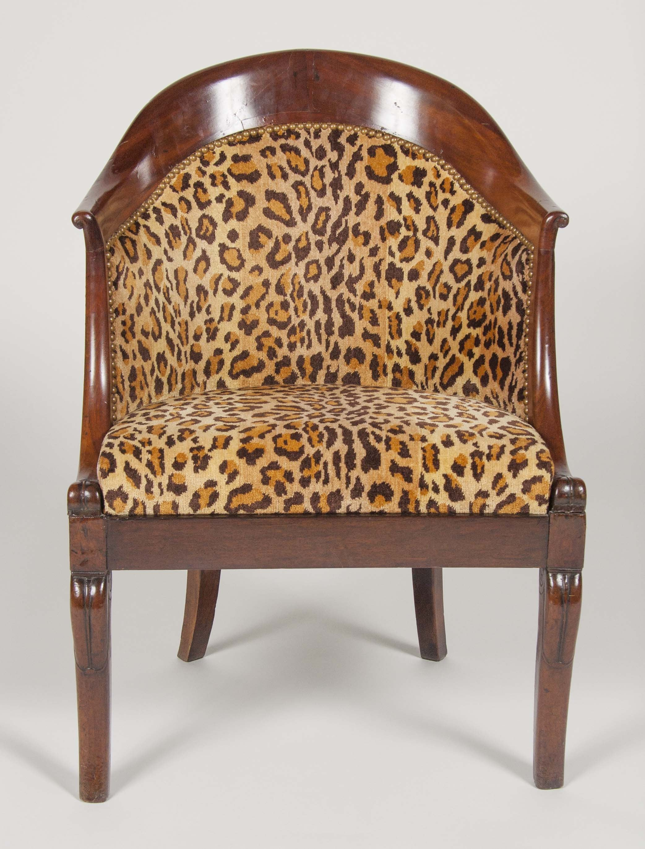 A tub back regency style chair