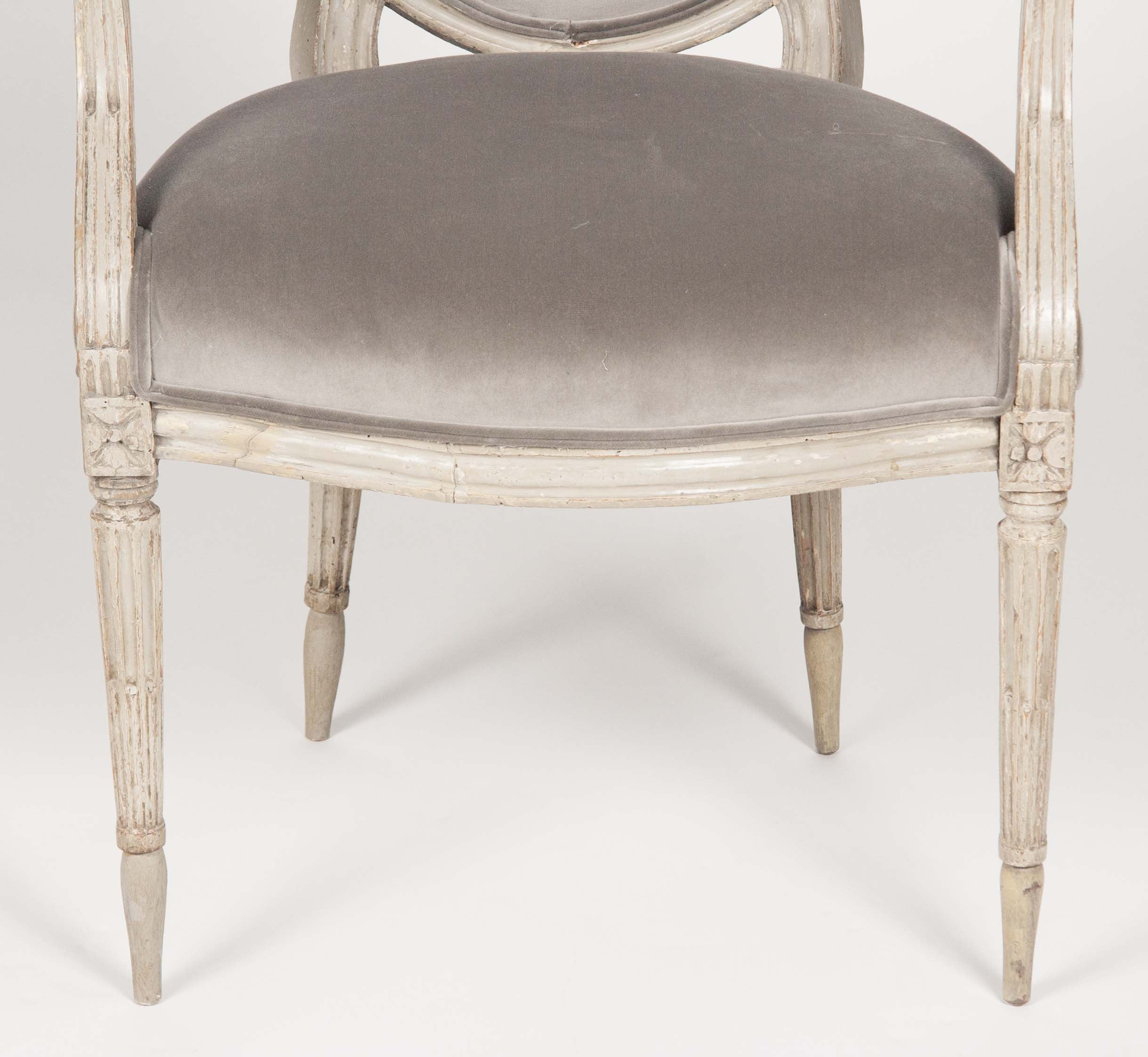 A Pair of Louis XVI Painted Arm Chairs