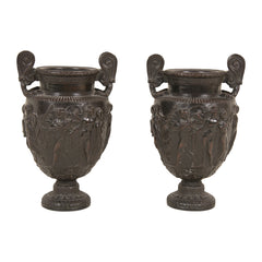 Pair of Bronze Bas Relief Urns