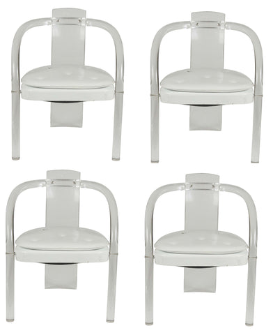 A Set of 4 Lucite Dining Chairs