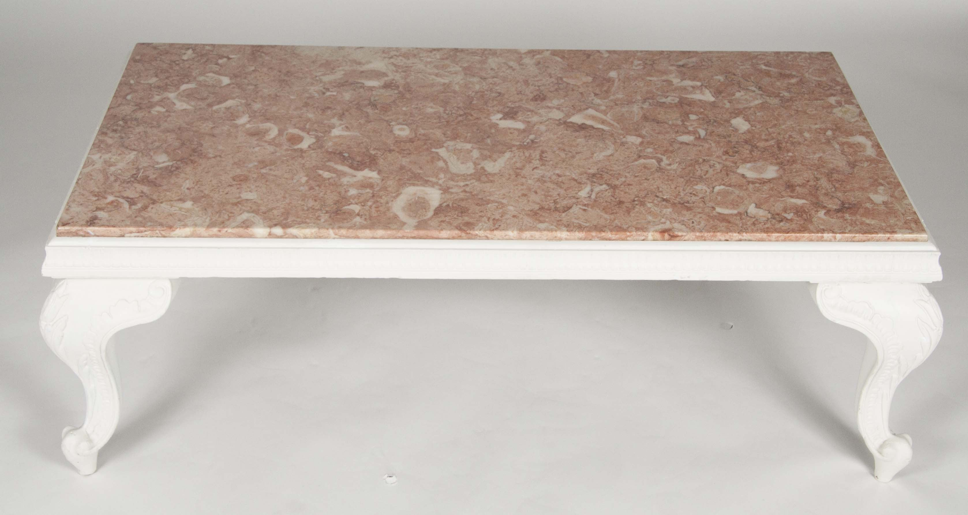 A Carved White Wood Coffee Table With Pink Marble Top